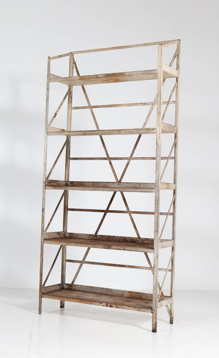 Stunning and rare Industrial shelving unit or storage rack. Design by Fa. Koller & Van Os Amsterdam. Striking Dutch design from the thirties. Welded-steel frame with a nice patina of oxidation and other wear -and -tear from years of use. Marked