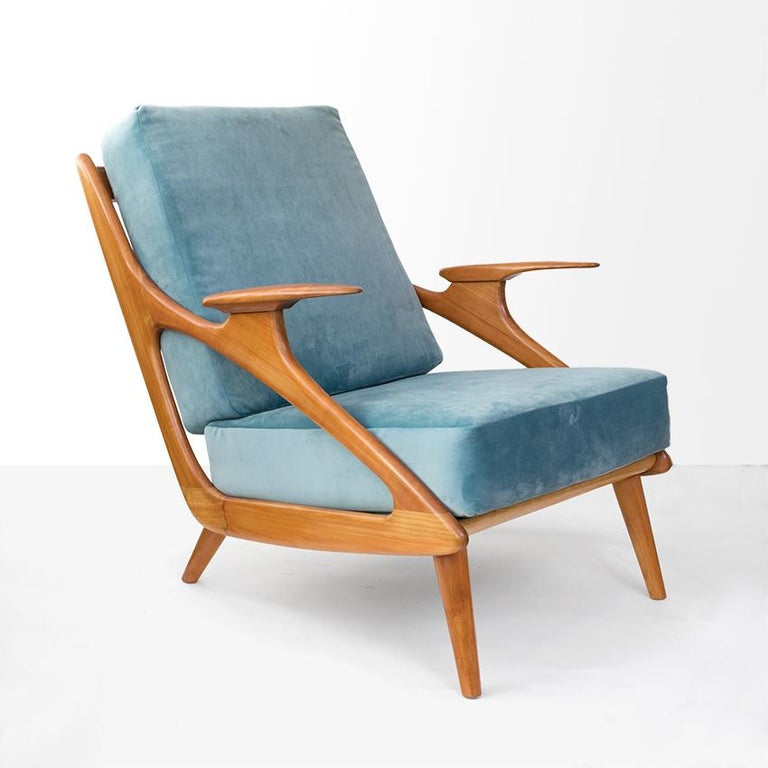 Ultra Mid-Century Modern carved cherrywood lounge chair with blue velvet upholstered cushions. Newly restored and reupholstered made by B. Spuij's, Netherlands, 1950s.   Measures: Height 33.5
