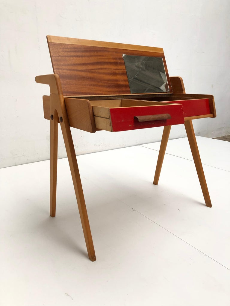 Unusual and rare modernist vanity desk produced in the Netherlands by Everest Furniture early 1950s.  Solid birch frame and, veneered plywood and exotic wood (Wenge) details in the construction.  1 drawer with Wenge grip on the left.  A make