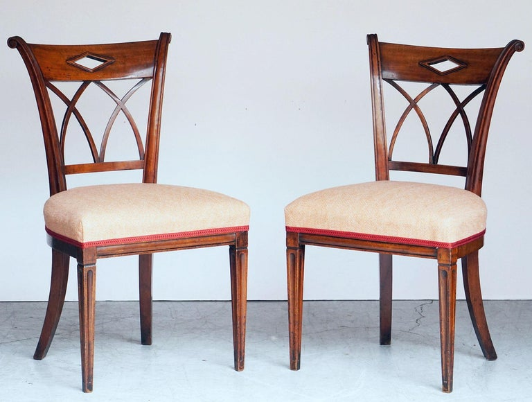 A set of four fine dining chairs of mahogany from Holland (The Netherlands), each chair featuring a rolled back with arch supports over a comfortable, upholstered seat, with tapering front legs and swaying back legs.  Four available - Individually