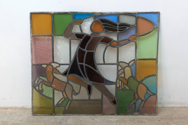 Stained-glass window in the series of children playing by the Dutch glass-artist Mengelberg executed for the children's Sanatorium. Beautiful combination of typical Art Deco clear and colored glass elements. by playing movement of a child. The