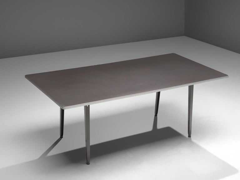 Friso Kramer for TH delft , conference table, metal, The Netherlands, 1940s.   This work table is designed by Friso Kramer in the 1940s. The table features a modest design, with slightly tapered legs that are tilted. This table is an example of the