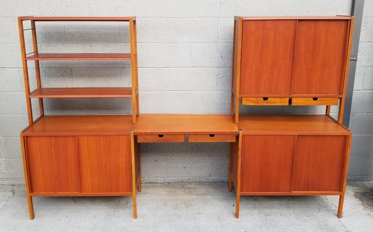 Exceptional Scandinavian Modern teak module wall unit by DUX Furniture, Sweden, circa 1950s-1960s. Beautiful glow to original finish. Consists of 5 units that can be easily moved and rearranged for specific needs. Two base cabinets, 2 uppers shelf