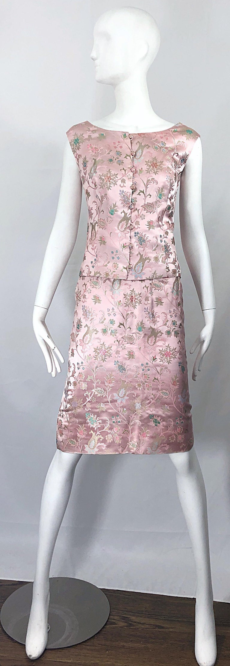 Utterly chic vintage 60s DYNASTY 3 piece light pink silk dress ensemble! The most beautiful light pink silk with intricate embrodiery in blues, greens, pinks and lavender purple throughout.  Features a sleeveless top that buttons up the front.