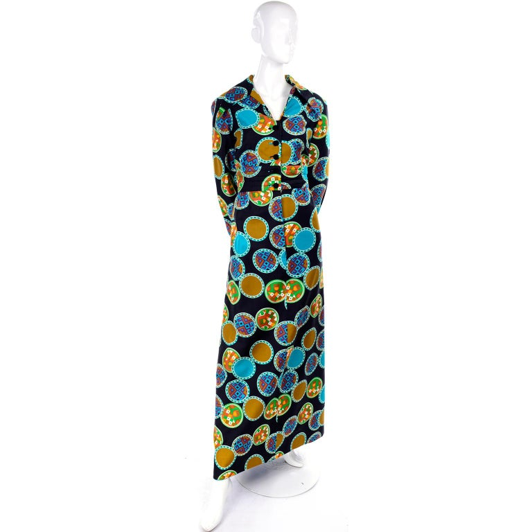This is a pretty vintage Dynasty early 1970's collared maxi dress with a colorful circle medallion print. We always grab these Dynasty dresses whenever we can find them because they were so well made in such beautiful fabrics. This  long sleeve maxi
