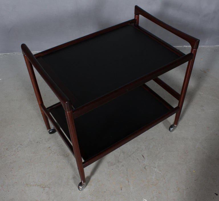Dyrlund bar cart in rosewood. Plates with Formica.  Mounted on wheels.  Made by Dyrlund in the 1960s.