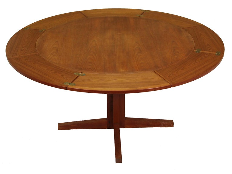 Very unique Lotus or flip flap dining table made by Dyrlund in Denmark in the 1960s. 