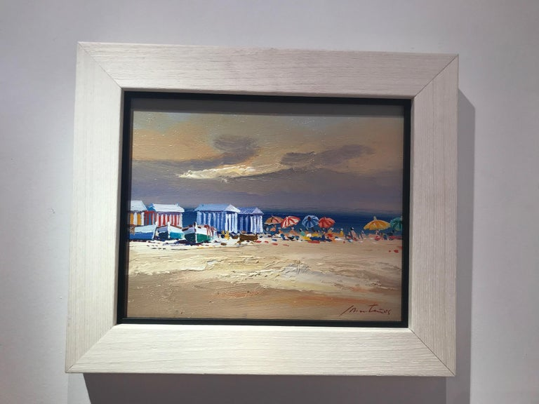 A warm and beautiful contemporary beach scene 'Beach Huts' by E. Martinez. This stunning seascape has a soft and natural colour palette, pale blues and earthy cool tones are subtle and mellow. Interesting textures create a warm and balanced