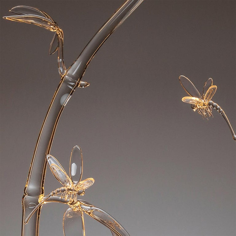 Inspired by traditional Japanese paintings, the Sumi-e, this original piece features the mating rituals of dragonflies. The installation, for use on a table, wall or ceiling, is framed in brass and comes with LEDs that shoot light through thick