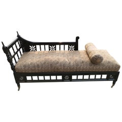 In the Style of E W Godwin, An Anglo-Japanese  Ebonized Chaise Lounge or Day Bed