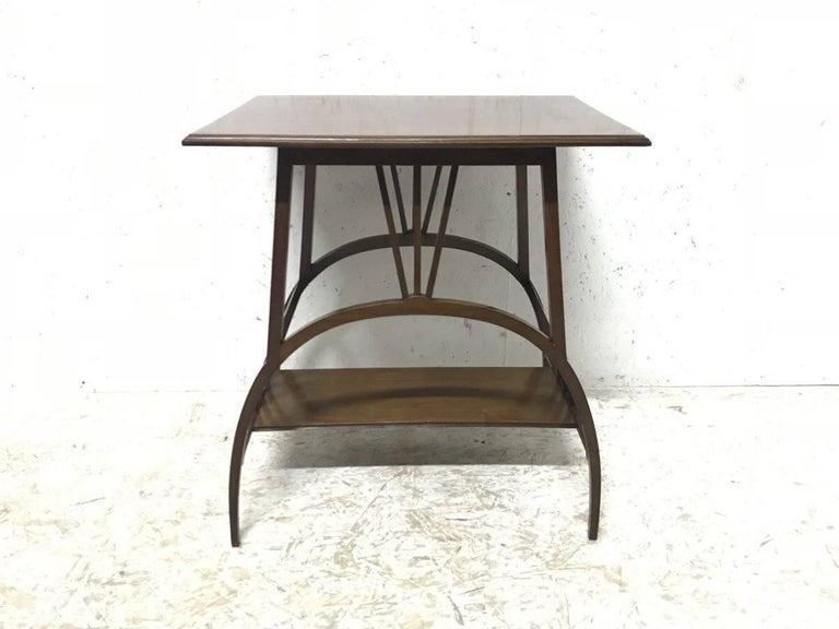 E W Godwin, attributed, probably made by Collinson & Lock. A rare and exceptional Anglo Japanese mahogany side table with semi-circular legs. The semi-circular legs with three Thebes style upper central supports at opposite sides emulating a sun