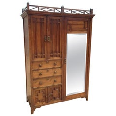 E W Godwin Style of, an Anglo-Japanese Walnut Double Armoire Wardrobe Compactum