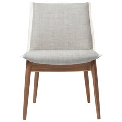 E004 Embrace Chair in Walnut Oil with Clara 144 Fabric & White Edging by EOOS