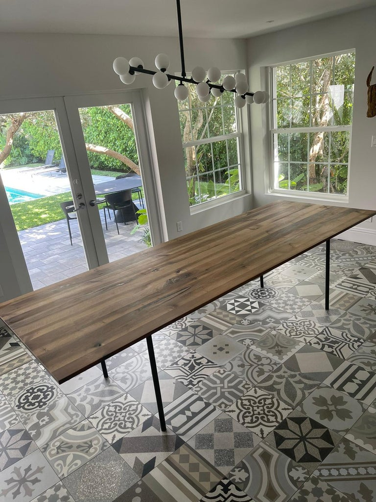 European Walnut, Black Base  280cm The table ANTON illustrates an uncompromising focus on the essentials with regards to material and form. The table top has been constructed using 11 solid wood planks and is only 20 MM (3/4 INCH) thick. The legs