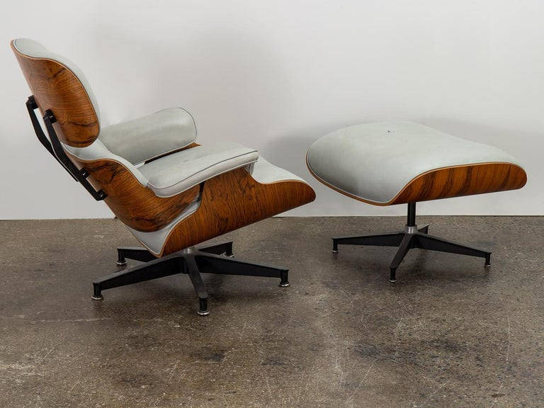 Original 670 lounge chair and matching 671 ottoman, designed by Charles and Ray Eames for Herman Miller. Custom light gray leather is in nice condition—lovingly worn and comfortably plush, with a nicely broken-in patina. Rosewood frame has been