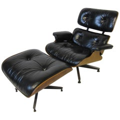 Eames Walnut 670 Lounge Chair with Ottoman by Herman Miller