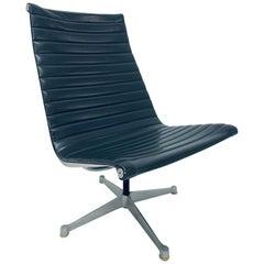 Eames Aluminum Group Dark Gray Swivel Lounge Chair for Herman Miller