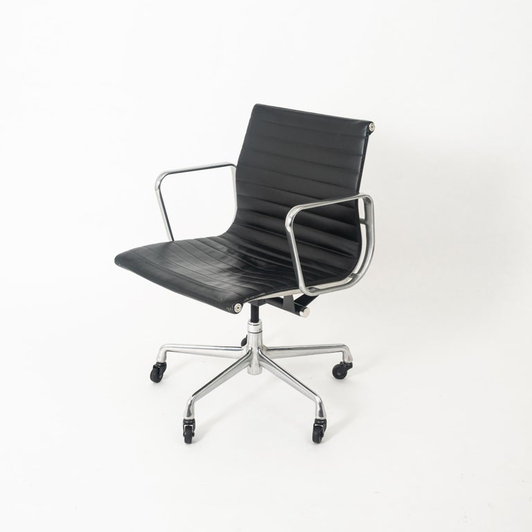 Designed by Charles and Ray Eames and offered by Herman Miller, this chair is as comfortable as it is a timeless classic. This Aluminum Group seat has a genuine black leather upholstery. The leather seat is a self-contouring, even weight