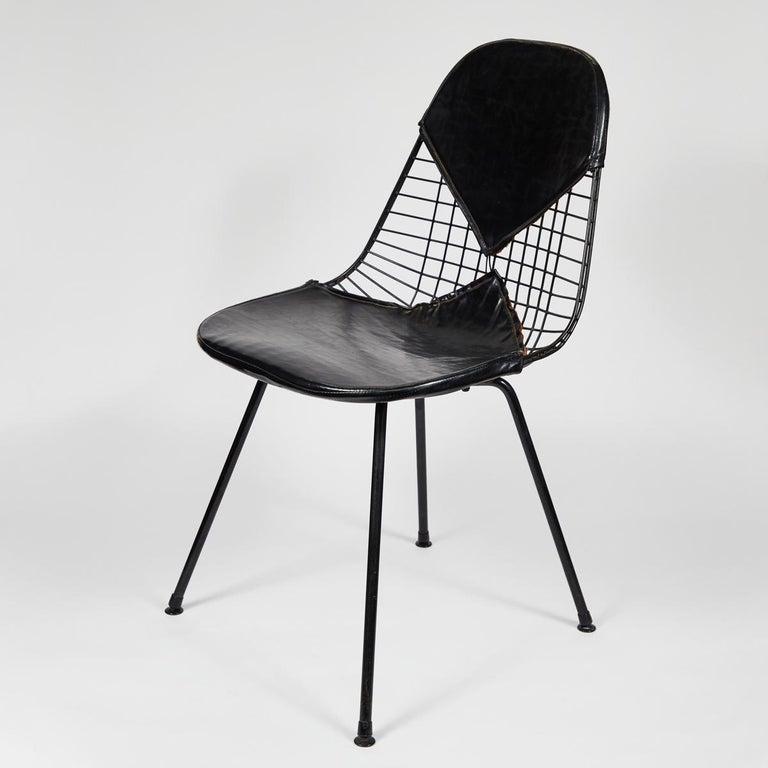 A set of four early Eames bikini chairs.