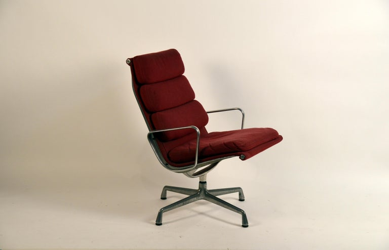 Burgungy soft pad swiveling lounge chair for Herman Miller. Model EA 216, designed by Charles & Ray Eames, 1969. Super comfortable.