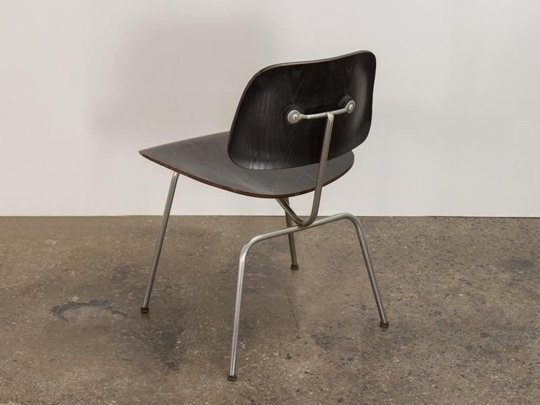 Early ebonized DCM dining chair, designed by Charles and Ray Eames, made by Evans for Herman Miller. Molded plywood has great age, wearing its original patina handsomely. Original finish is unaltered. In excellent shape, with very clean edges. Minor