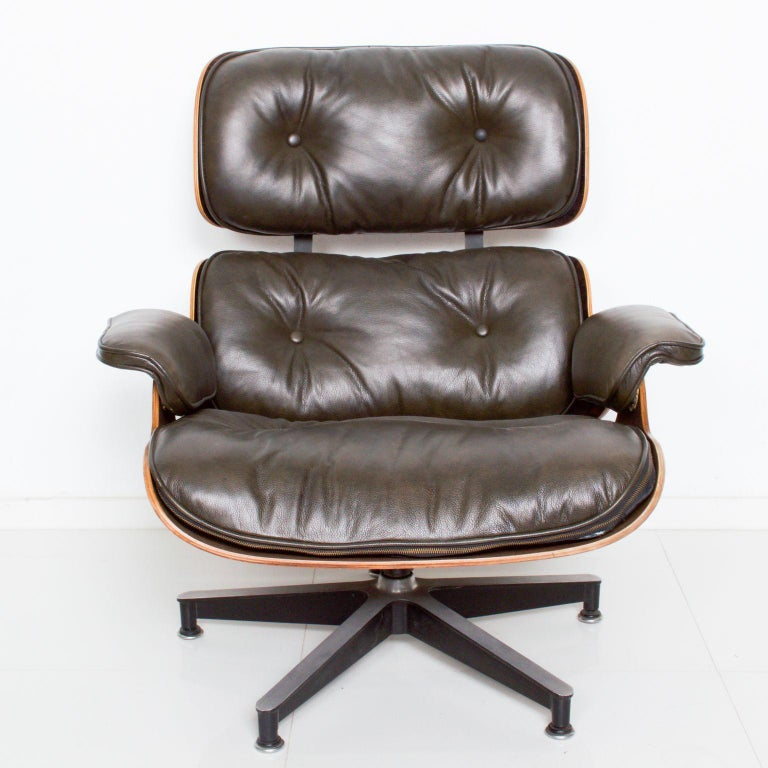 Mid-Century Modern Eames for Herman Miller Dark Green Leather Lounge Chair and Ottoman For Sale
