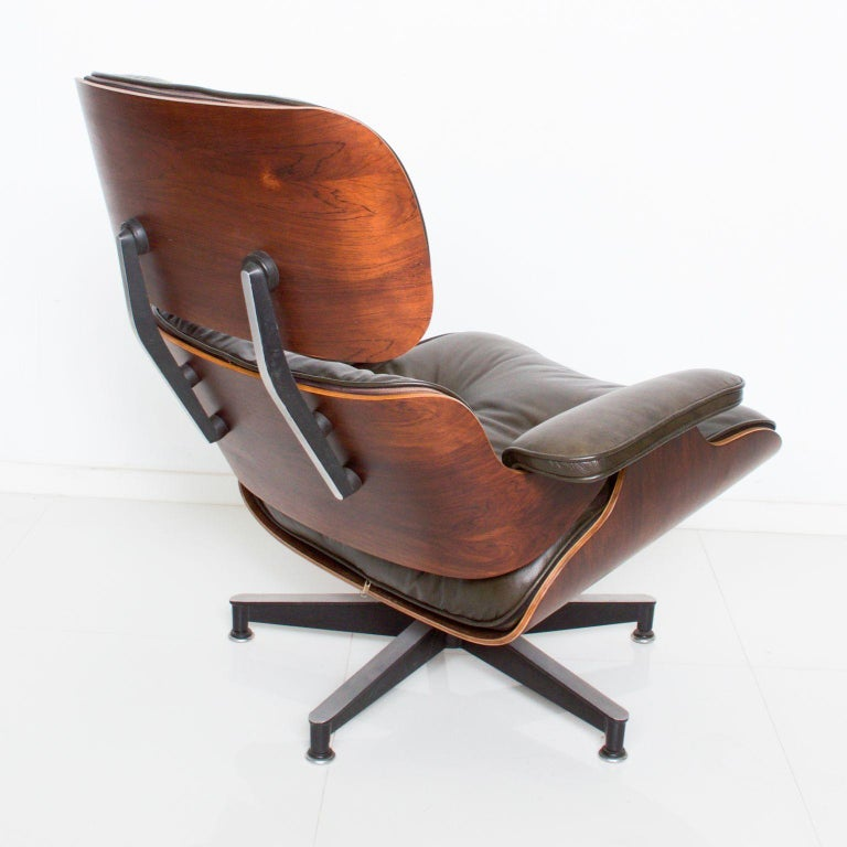 Mid-20th Century Eames for Herman Miller Dark Green Leather Lounge Chair and Ottoman For Sale
