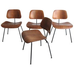 Four Eames Pre-production Walnut Plywood DCM Chairs, 1946