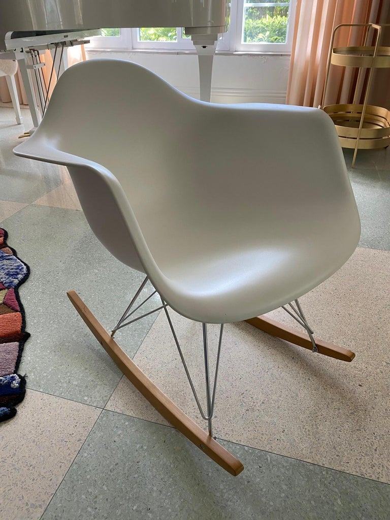 The one-piece shell of this modern rocking chair is molded in 100 percent recyclable polypropylene, which gives it a soft matte finish as light plays across its shadows and contours. The colorful shell is supported by a wire frame and lovely