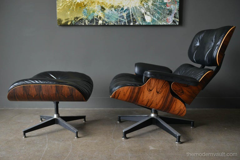 Eames rosewood lounge chair and ottoman, circa 1971. Original Charles Eames 670 and 671 lounge chair and ottoman for Herman Miller in black leather and rosewood. Beautiful patina to the leather, original 5 star base with domes of silence floor