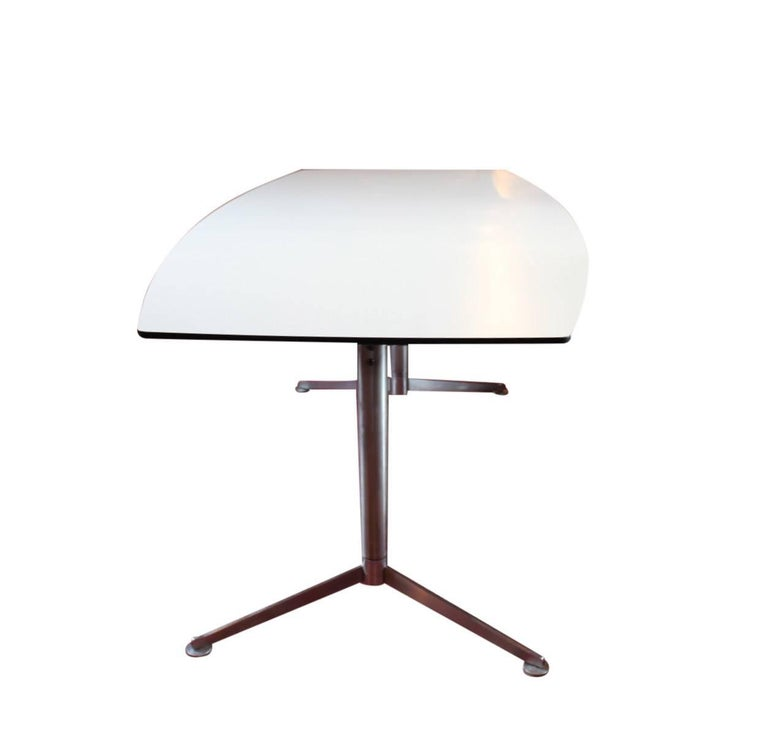 Eames segmented table designed by Charles & Ray Eames in 1964 and manufactured by Vitra in 2005. The table is with a tabletop of white laminate with a black edge.