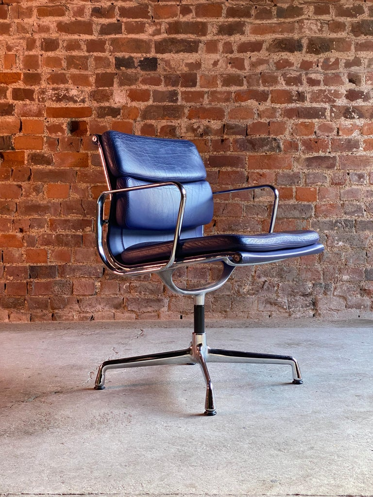 Eames Soft Pad Group EA208 by Vitra Charles & Ray Eames, circa 2000  Eames Soft Pad Chair EA 208 by Vitra, this is a swivel version in blue leather raised on chrome base, the leather shows signs of use but with no tears or rips, a beautiful chair