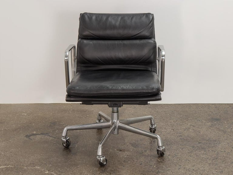 Vintage soft pad management swivel chair in black leather, designed by Charles and Ray Eames for Herman Miller. The ultimate desk chair that delivers function and comfort. Known for their seat cushions, our vintage example is incredibly plush is