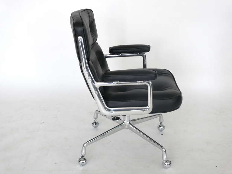 Classic office chair from the Time Life building in New York. Designed by Eames featuring newly upholstered black leather, new casters and a newly polished chrome base and frame. Chair is height adjustable with tilt and swivel.