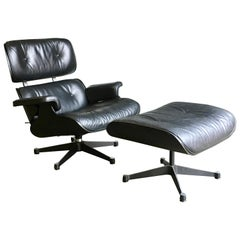 Eames Vitra 670 and 671 Black Nero Leather Lounger and Footstool in Black Ash