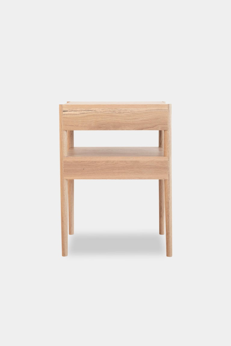 Open up its two floating slow closing drawers to stow away all your bedside essentials. This nightstand is solid wood constructed, with turned legs, and handcut joints.  Wood options are natural oak, ebonized oak, or walnut. We can also make the