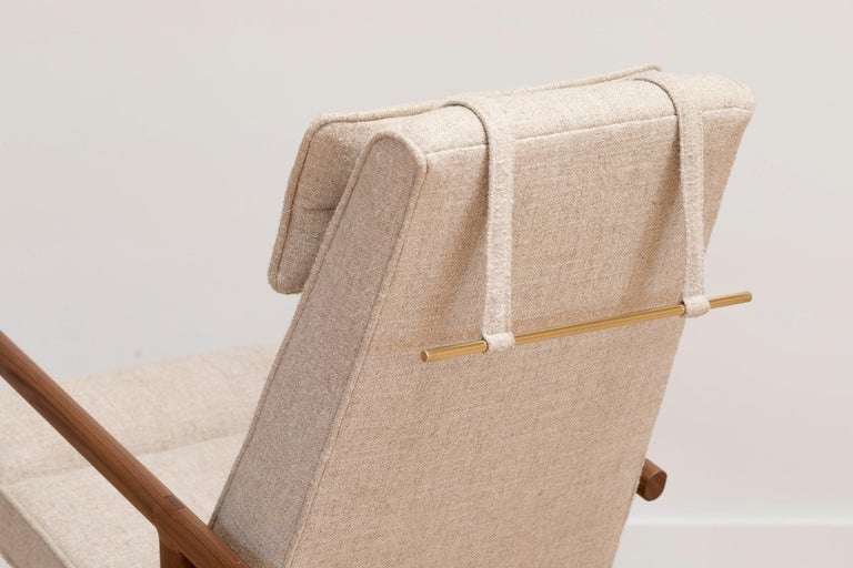 Solid wood construction with hand-cut joinery and custom upholstered seat and seat back. This Rocker shown in walnut and maharam plume ciabatta ivory textured linen.  In stock leather choice: black, olive, camel or vegtan leather. Wood choice: