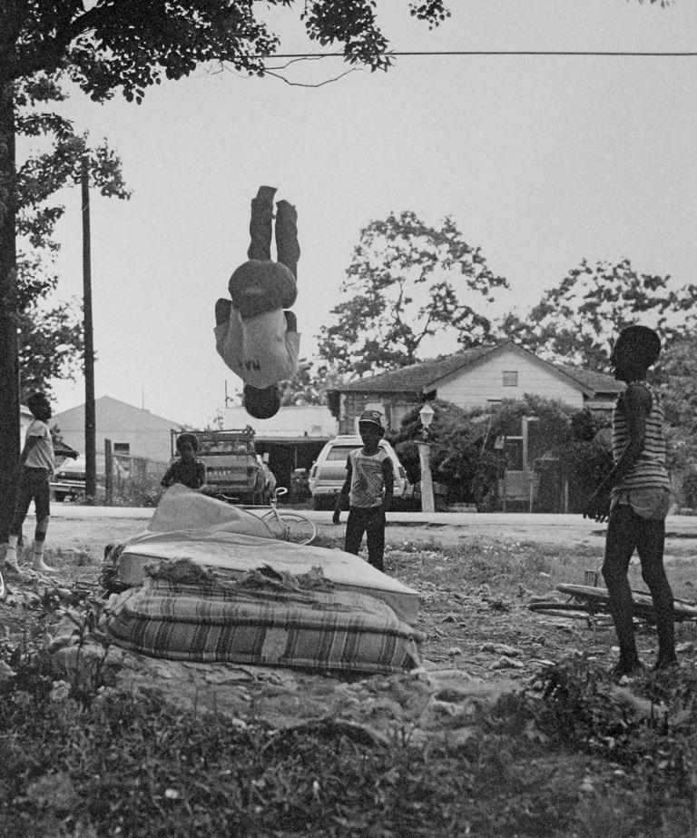 Earlie Hudnall Jr. Portrait Photograph - Bouncing Boys, 3rd Ward, Houston, Texas
