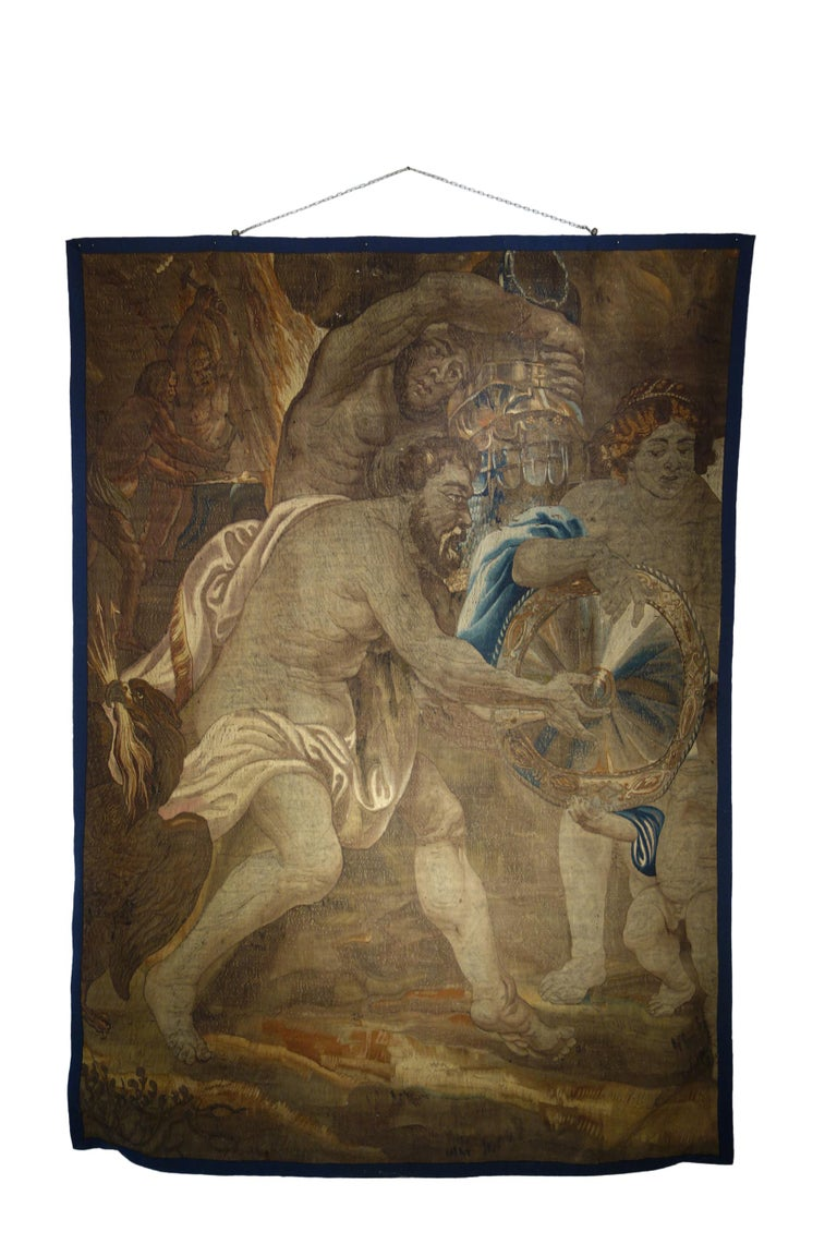 Early 1600s impressive Flemish tapestry fragment depicting Vulcan; Roman god of Fire & The Forge, son of Jupiter & Juno, and husband of Venus. He is preparing the shield armor and weaponry for Achilles, who will be the most famous warrior of the