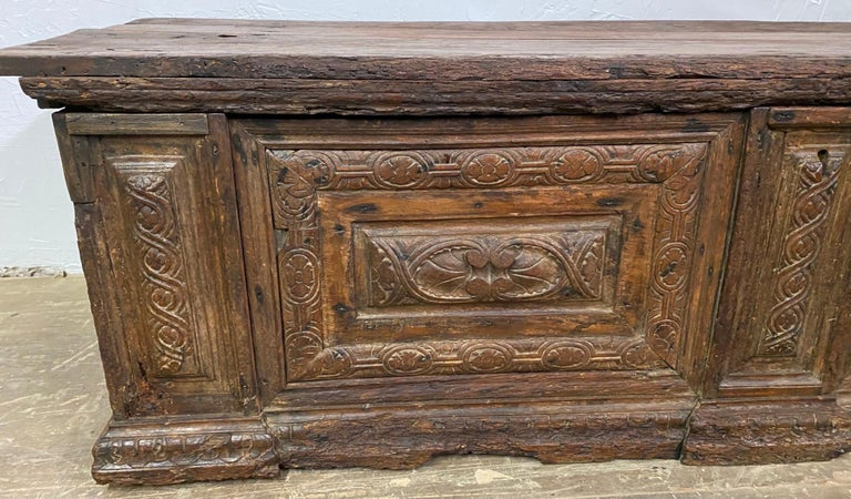 A wonderfully rustic early Italian Cassone with handsome time-softened wood and carved panels on the front and sides. Although this chest has suffered wood worm damage, losses to various areas and repairs made, it has only added to the charm,