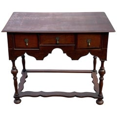 Early 18th Century British Three-Drawer Oak and Walnut Lowboy