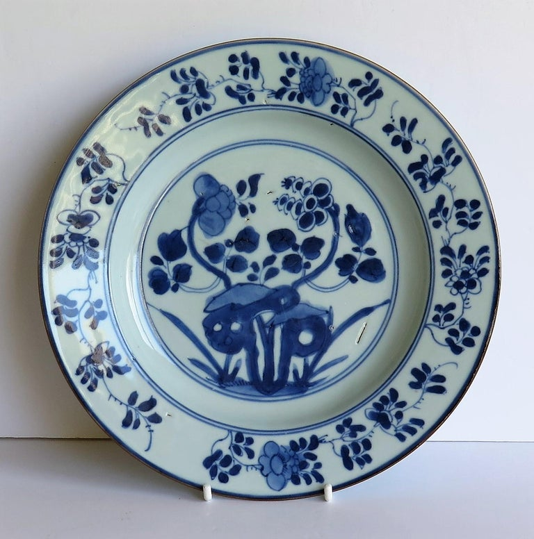 This is a beautiful hand painted Chinese porcelain plate, dating to the first half of the 18th century, circa 1720-1740, Qing dynasty.  The plate is well potted, and has been hand decorated in varying shades of cobalt 'steel' blue. The glaze is