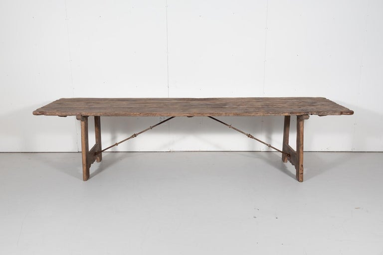 Early 18th century French trestle table handcrafted of mélèze wood by talented artisans near Strasbourg for a hunting lodge in the Alsace region of France, circa 1720s. This wonderfully rustic table with its centuries old patina has a plank top with
