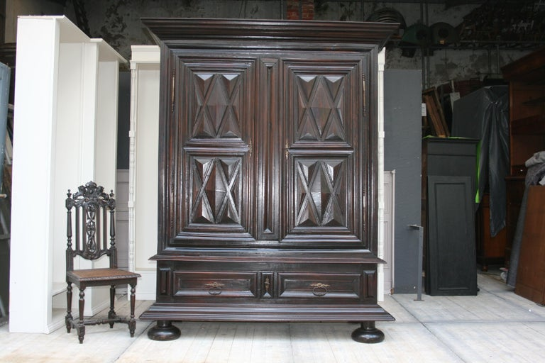 Exceptional large French Louis XII armoire from the early 18th century made of walnut and oak. 