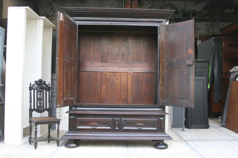 French Early 18th Century Walnut Louis XII Armoire with Carved Diamond Point Panels For Sale