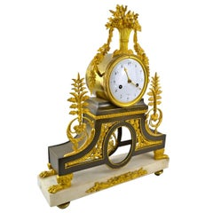 Early 19th Century French Directoire Gilt Bronze and Marble Clock by Deverberie