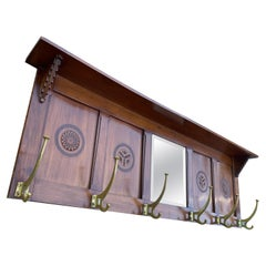 Early 1900 Arts & Crafts Coat Rack with Stylish Carved Panels and Beveled Mirror