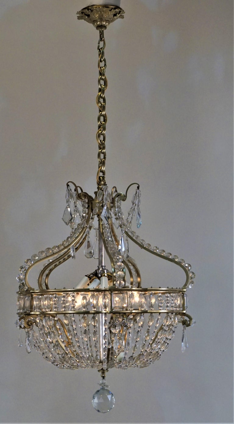 Elegant French early 1900 cast bronze frame with beautiful cut crystal prisms and chain chandelier. Measurement: 21