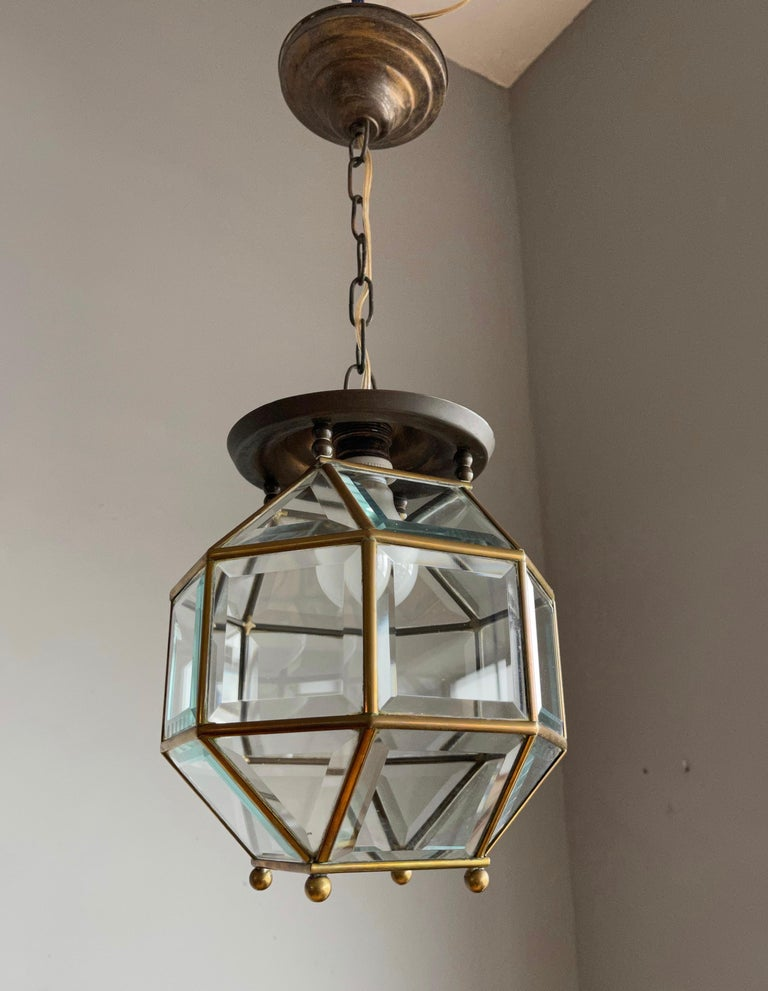 Excellent condition brass and beveled glass lantern.  This stylish design is all handmade and in excellent condition. It has a total of twenty four rectangular, beveled glass sections framed in brass and together they form a classy and timeless