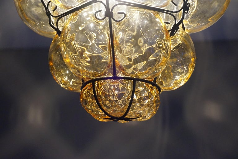Early 1900s Mouthblown Amber Glass in Iron Frame Venetian Pendant or Chandelier In Good Condition For Sale In Lisse, NL